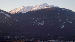 The village of Whistler, B.C. is seen as the sun sets on the snow capped mountains Friday, Feb. 3, 2012. THE CANADIAN PRESS/Jonathan Hayward