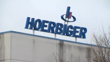 The Hoerbiger sign atop a building