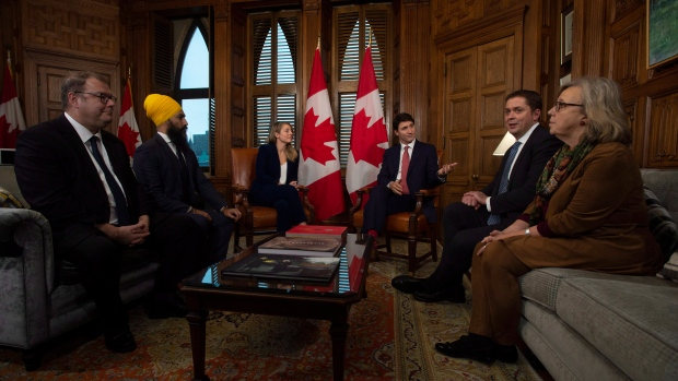 Prime Minister Justin Trudeau gestures to Leader of the Opposition Andrew Scheer as Bloc interim leader Mario Beaulieu(left), NDP leader Jagmeet Singh, Tourism, Official Languages and La Francophonie Minister Melanie Joly and Green party leader Elizabeth May meet in the prime ministers office to discuss francophone issues in Ottawa, Wednesday November 28, 2018. THE CANADIAN PRESS/Adrian Wyld