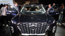 Attendees look at the 2020 Hyundai Palisade
