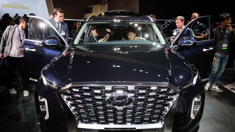 Attendees look at the 2020 Hyundai Palisade at the Los Angeles Auto Show Wednesday, Nov. 28, 2018, in Los Angeles. (AP Photo/Jae C. Hong)