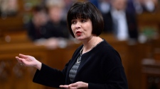Minister of Health Ginette Petitpas Taylor rises during Question Period in the House of Commons on Parliament Hill in Ottawa on Monday, Nov. 26, 2018. THE CANADIAN PRESS/Justin Tang