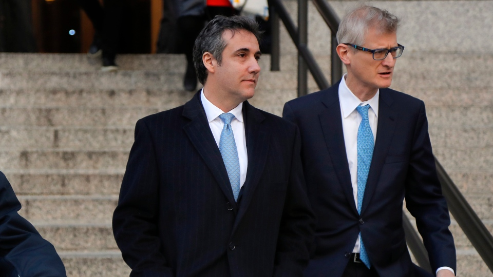 Michael Cohen, left, walks out of federal court with his attorney Guy Petrillo, Thursday, Nov. 29, 2018, in New York, after pleading guilty to lying to Congress about work he did on an aborted project to build a Trump Tower in Russia. (AP Photo/Julie Jacobson)