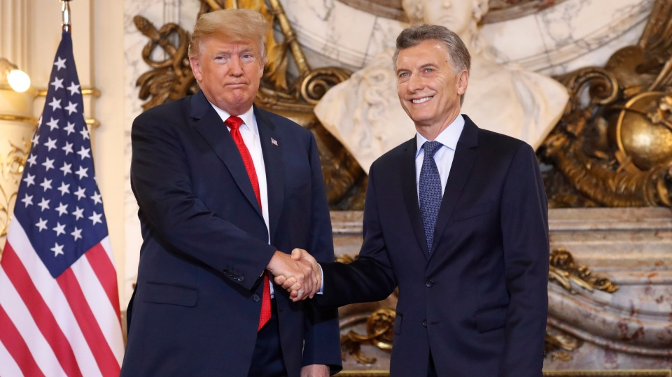 President Donald Trump with Argentina's President Mauricio Macri during their meeting at Casa Rosada, Friday, Nov. 30, 2018 in Buenos Aires, Argentina. (AP Photo/Pablo Martinez Monsivais)