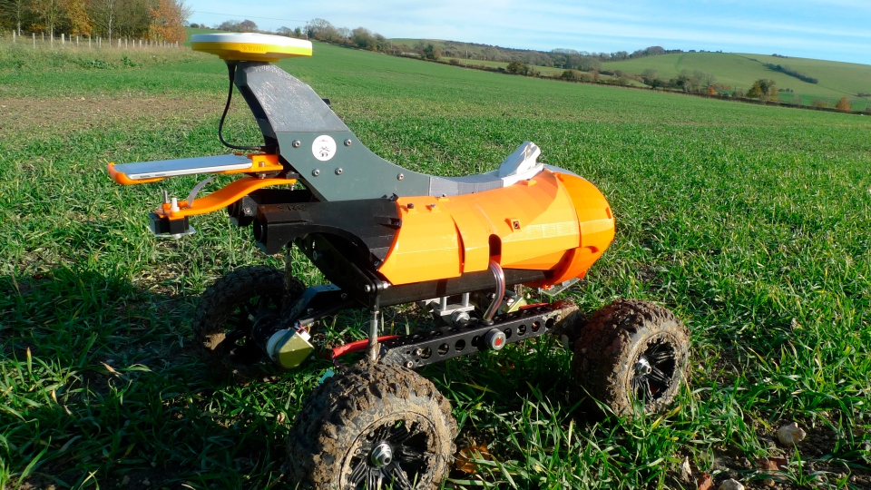 "A farming robot named ""Tom"" produced by Small Robot Company as part of a field trial to develop new farm technologies, in East Meon, southern England, Friday Nov. 30, 2018. (AP Photo / Kelvin Chan)"