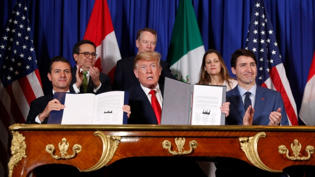 President Donald Trump, Canada's Prime Minister Justin Trudeau, right, and Mexico's President Enrique Pena Neto, left, participate in the USMCA signing ceremony, Friday, Nov. 30, 2018 in Buenos Aires, Argentina. (AP Photo/Pablo Martinez Monsivais)