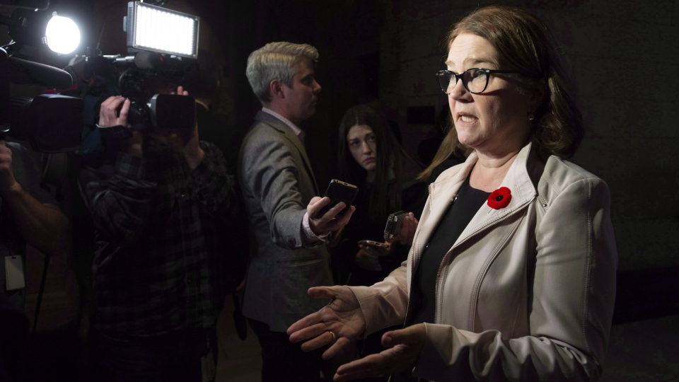 Indigenous Services Minister Jane Philpott speaks with the media before Question Period in the Foyer of the House of Commons in Ottawa on October 31, 2018. THE CANADIAN PRESS/Adrian Wyld