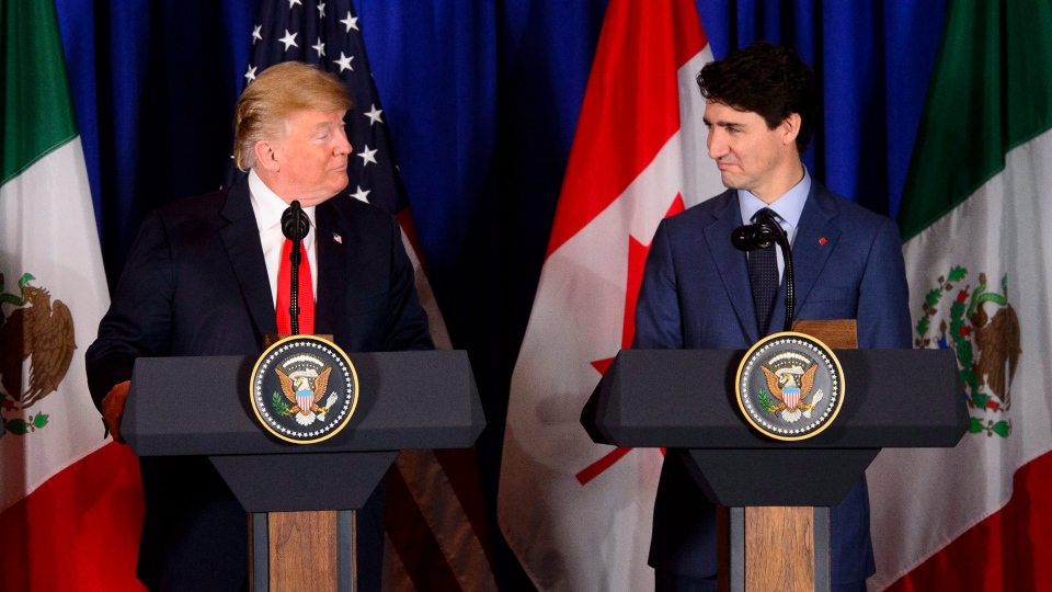 Prime Minister Justin Trudeau, right, and President of the United States Donald Trump participate in a signing ceremony for the new United States-Mexico-Canada Agreement with President of Mexico Enrique Pena Nieto (not shown) in Buenos Aires, Argentina on Friday, Nov. 30, 2018. THE CANADIAN PRESS/Sean Kilpatrick