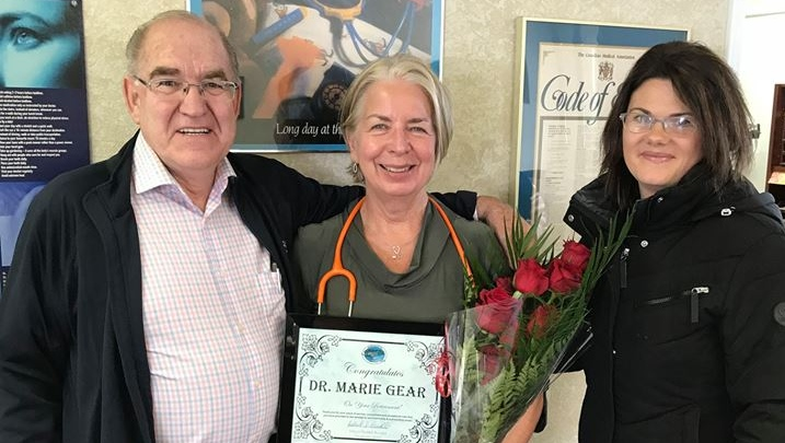 Dr. Marie Gear, center, is presented with the 2019 Council Award from the College of Physicians and Surgeons of Ontario. (Source: Municipality of South Bruce)