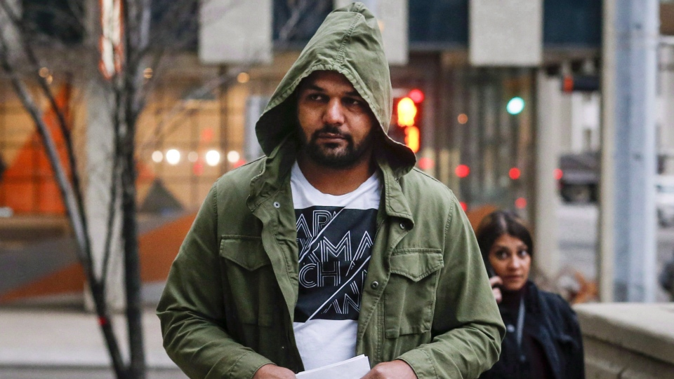 Sukhmander Singh, owner of the trucking company involved in the Humboldt Broncos bus crash, arrives at court to face non-compliance charges under federal and provincial safety regulations in Calgary on November 9, 2018. (Jeff McIntosh/ The Canadian Press)