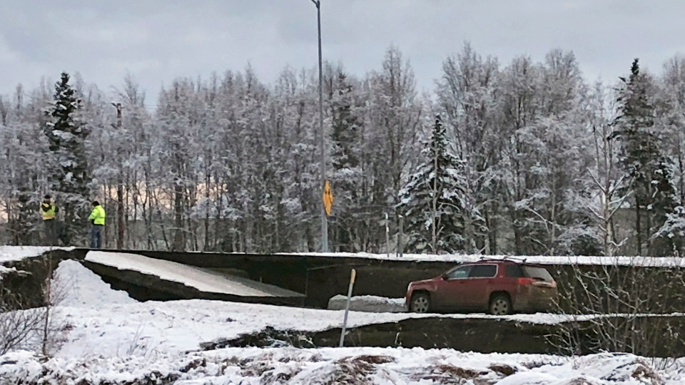 A car is trapped on a collapsed section of the off-ramp off of Minnesota Drive in Anchorage, Friday, Nov. 30, 2018.(AP Photo/Dan Joling)