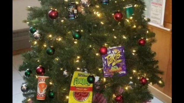 Image result for 2 Minneapolis cops on leave after Christmas tree decor