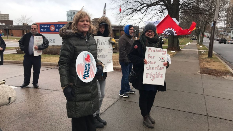 Janet Hazelton, the president of the Nova Scotia Nurses Union, and Danny Cavanagh of the Nova Scotia Federation of Labour were among the union leaders who joined the protest at Canada Post's Almon Street facility in Halifax.
