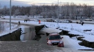 A car is trapped on a collapsed section of the offramp of Minnesota Drive in Anchorage, Friday, Nov. 30, 2018.  (AP Photo/Dan Joling)