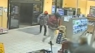 This image taken from YouTube video shows two suspects sought in a robbery in Windsor, Ont. on Tuesday, Nov. 27, 2018. (Windsor Police / YouTube)