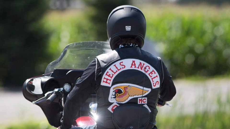 A member of the Hells Angels arrives for a national gathering in Saint-Charles-sur-Richelieu, Que., Friday, August 10, 2018.THE CANADIAN PRESS/Graham Hughes