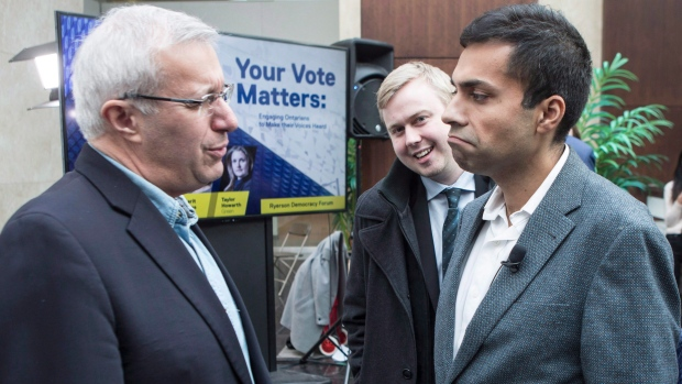 In this file photo, former interim PC Leader Vic Fedeli, left, talks to Chief of Staff Alykhan Velshi as they attend a panel discussion on electoral absenteeism among youth and minority groups, at Toronto's Ryerson University on Wednesday, February 28, 2018. (THE CANADIAN PRESS/Chris Young)