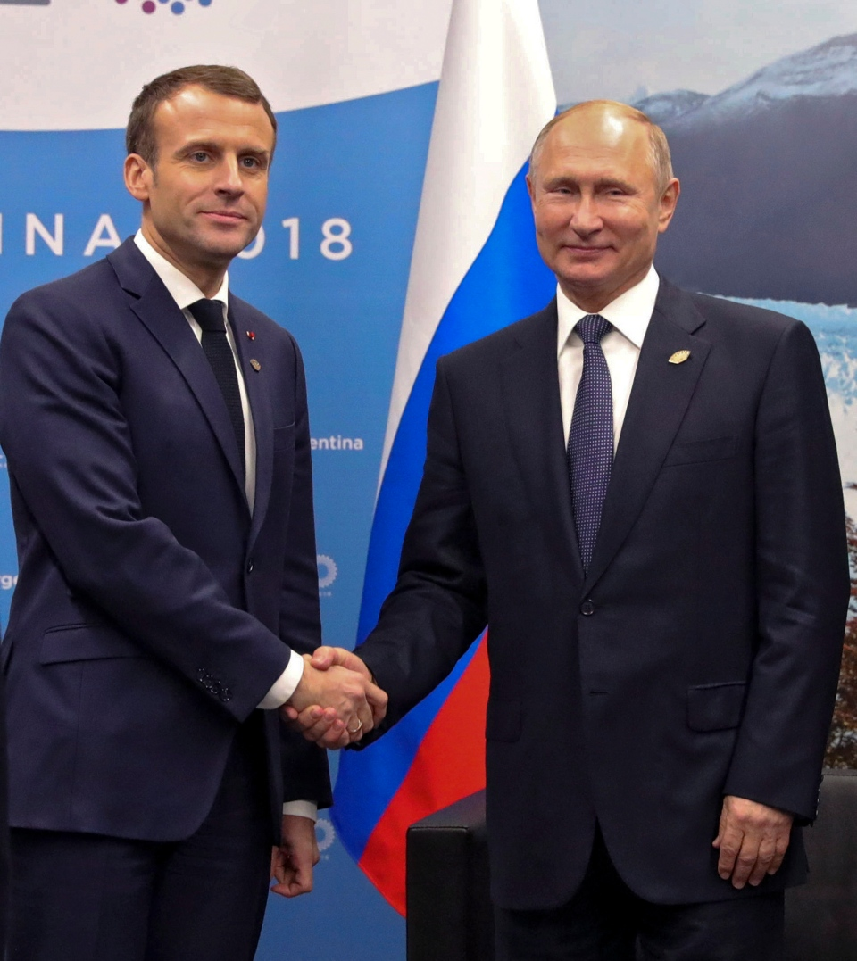 Russian President Vladimir Putin, right, and France's President Emmanuel Macron pose for a photo prior to their talks at the G20 summit in Buenos Aires, Argentina, Friday, Nov. 30, 2018. (Mikhail Klimentyev, Sputnik, Kremlin Pool Photo via AP)