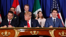 U.S. President Donald Trump, Canada's Prime Minister Justin Trudeau, right, and Mexico's President Enrique Pena Neto, left, participate in the USMCAsigning ceremony, Friday, Nov. 30, 2018 in Buenos Aires, Argentina. (AP / Pablo Martinez Monsivais)