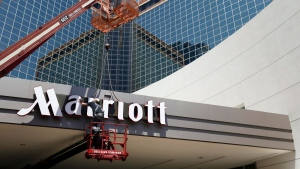 In this Tuesday, April 30, 2013, file photo, a man works on a new Marriott sign in front of the former Peabody Hotel in Little Rock, Ark. Marriott says the information of up to 500 million guests at its Starwood hotels has been compromised. (AP /Danny Johnston, File)