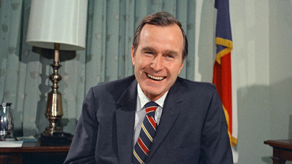 In this Dec. 18, 1970, file photo, newly appointed United Nations Ambassador George H. Bush smiles. (AP Photo/John Duricka, File)
