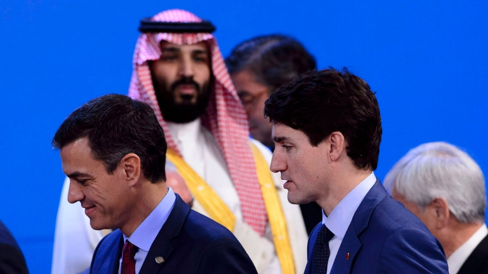 Crown Prince of Saudi Arabia Mohammed Bin Salman, top, looks towards Prime Minister Justin Trudeau, bottom right, as they arrive to take part in a family photo at the G20 Summit in Buenos Aires, Argentina on Friday, Nov. 30, 2018. THE CANADIAN PRESS/Sean Kilpatrick