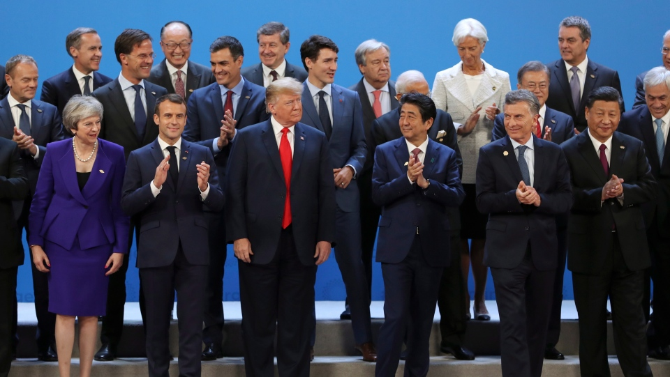 World leaders gather for a group photo at the start of the G20 Leader's Summit at the Costa Salguero Center in Buenos Aires, Argentina, Friday, Nov. 30, 2018. (AP Photo/Ricardo Mazalan)