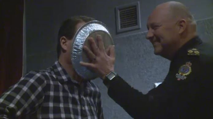 Mayor Michael Fougere took a pie to the face from Regina Police Chief Evan Bray as part of a fundraiser for Carmichael Outreach on Dec. 1, 2018.