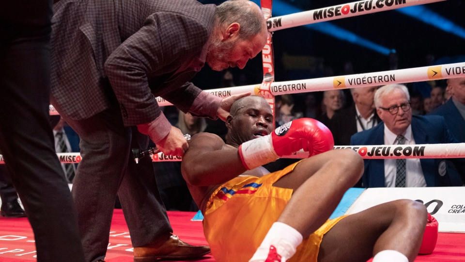 Ring doctor Marc Gagne, left, checks on Adonis Stevenson, of Montreal, after he was knocked out by Oleksandr Gvozdyk of Ukraine in their Light Heavyweight WBC championship fight, Saturday, December 1, 2018 in Quebec City. (THE CANADIAN PRESS / Jacques Boissinot)