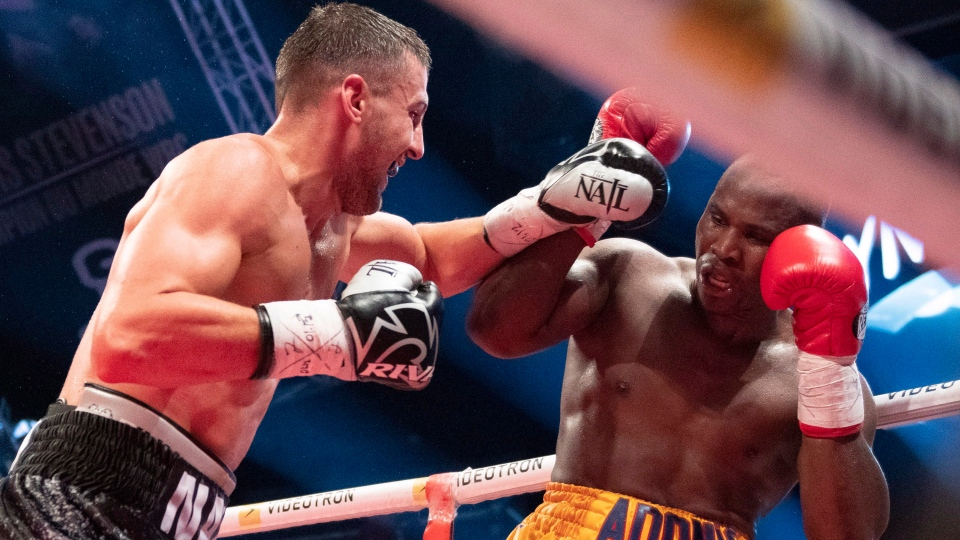 Oleksandr Gvozdyk, of Ukraine, forces Adonis Stevenson, of Montreal, in the corner during their Light Heavyweight WBC championship fight, Saturday, December 1, 2018 in Quebec City. (THE CANADIAN PRESS / Jacques Boissinot)