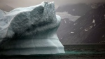 In this July 26, 2011 photo, a melting iceberg floats along a fjord leading away from the edge of the Greenland ice sheet near Nuuk, Greenland. (AP Photo/Brennan Linsley, File)