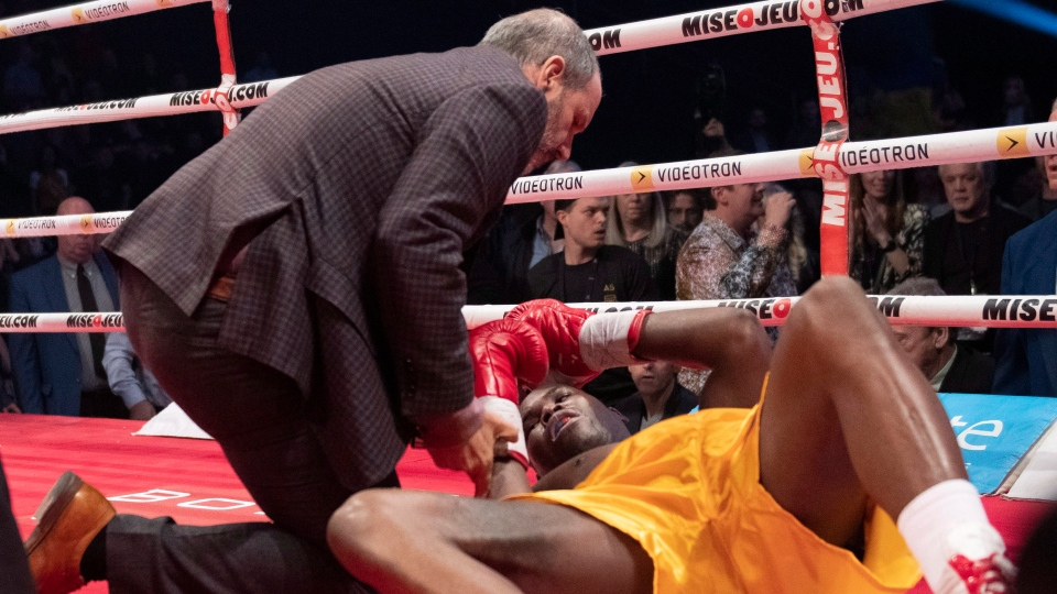 Ring doctor Marc Gagne, left, checks on Adonis Stevenson, of Montreal, after he was knocked out by Oleksandr Gvozdyk, of Ukraine, in their Light Heavyweight WBC championship fight, Saturday, December 1, 2018 in Quebec City. THE CANADIAN PRESS/Jacques Boissinot