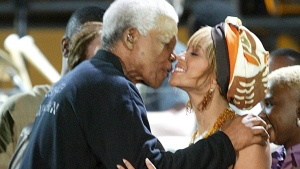 This Nov. 29, 2003 file photo shows former South African President Nelson Mandela, kissing U.S. singer Beyonce Knowles, at the Nelson Mandela AIDS Benefit Concert in Cape Town, South Africa. (AP Photo/file)