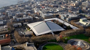 In this Dec. 4, 2017, file photo, the iconic sloped roof of KeyArena, center, a sports and entertainment venue at the Seattle Center, is seen in an aerial photo in Seattle.  (AP Photo/Elaine Thompson, File)