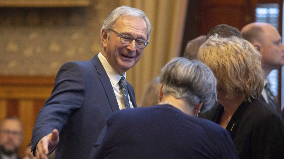 New Brunswick Premier Blaine Higgs chats with members of the public prior to the Throne Speech at the New Brunswick Legislature in Fredericton, N.B., on Tuesday, Nov. 20, 2018.  (THE CANADIAN PRESS/James West)