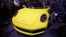 Attendees gather around the 2020 Porsche 911 at the Los Angeles Auto Show Wednesday, Nov. 28, 2018, in Los Angeles. (AP Photo/Jae C. Hong)