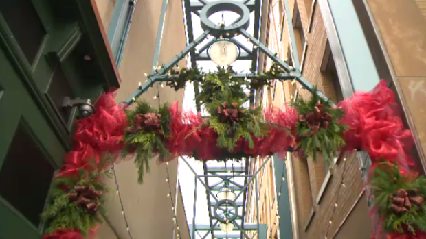 A laneway decorated with Christmas fare