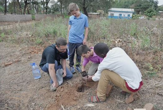 The Linsley family buries their grandfather's ashes in his hometown in Malawi. (Courtesy Marie Sellar)
