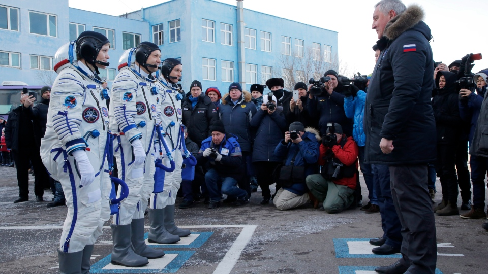 U.S. astronaut Anne McClain, left, Russian cosmonaut –Oleg Kononenko, centre, and CSA astronaut David Saint Jacques, members of the main crew of the expedition to the International Space Station (ISS), report to head or Russian space agency Dmitry Rogozin prior to the launch of Soyuz MS-11 space ship at the Russian leased Baikonur cosmodrome, Kazakhstan, Monday, Dec. 3, 2018. (AP Photo/Dmitri Lovetsky, Pool)