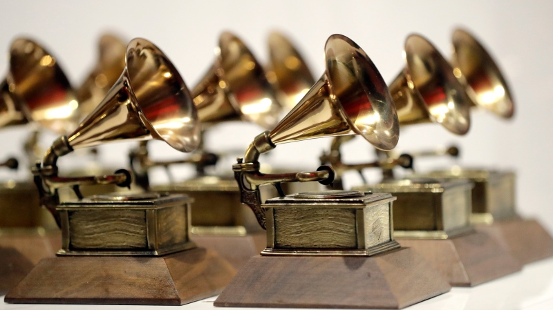 In this Oct. 10, 2017, file photo, various Grammy Awards are displayed at the Grammy Museum Experience at Prudential Center in Newark, N.J. AP Photo/Julio Cortez, File)
