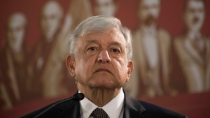 Mexico's President Andres Manuel Lopez Obrador holds his first news conference as president, which started at 7 a.m. local time in Mexico City, Monday, Dec. 3, 2018. (AP Photo/Christian Palma)