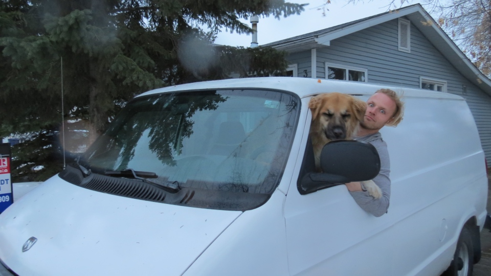 Jesse Boldt sold his house in April and moved into the van with his dog Layla.