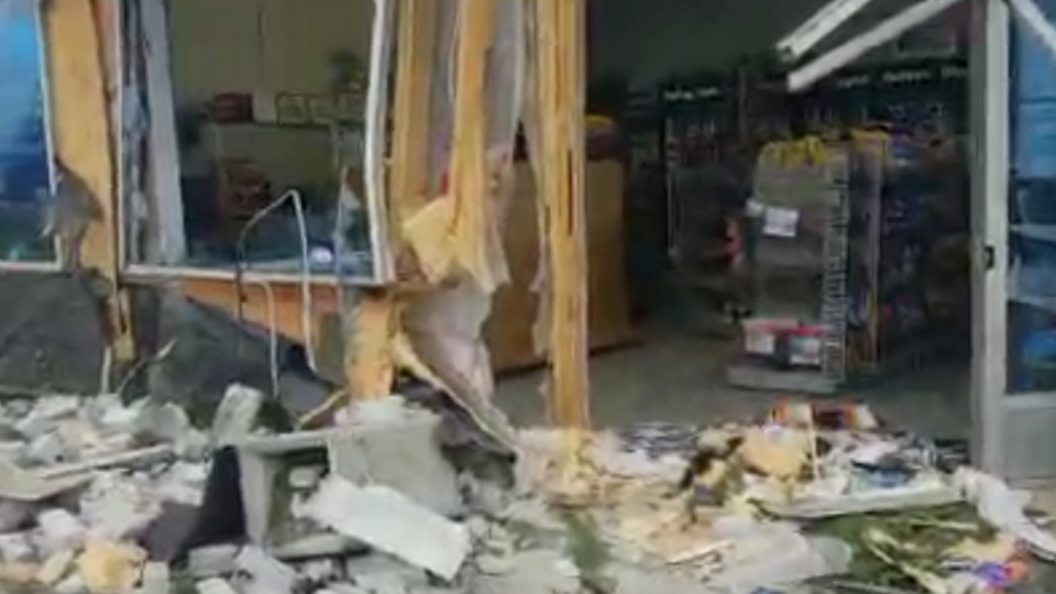 In this image taken from video, damage to a gas station after an ATM theft is seen in Port Rowan, Ont. on Monday, Dec. 3, 2018. (@OPP_WR / Twitter)