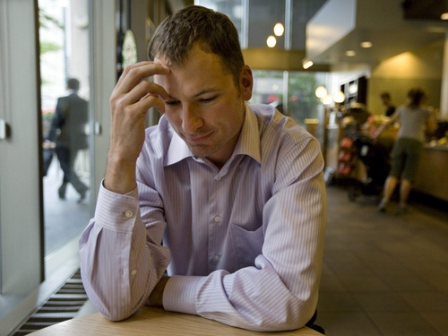 """Ben Mariano, who suffers from misophonia, or """"hatred of sound"""", sits in a busy coffee shop in downtown Toronto on Wednesday, July 8, 2009. (Darren Calabrese / THE CANADIAN PRESS)"""