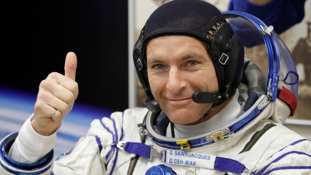 CSA astronaut David Saint Jacques, member of the main crew of the expedition to the International Space Station (ISS), gestures prior to the launch of Soyuz MS-11 space ship at the Russian leased Baikonur cosmodrome, Kazakhstan, Monday, Dec. 3, 2018. (AP Photo/Dmitri Lovetsky)