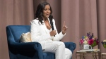 """Former first lady Michelle Obama speaks during the """"Becoming: An Intimate Conversation with Michelle Obama"""" at Barclays Center in Saturday, Dec. 1, 2018, in New York. (AP Photo/Mary Altaffer)"""