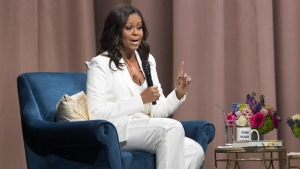 "Former first lady Michelle Obama speaks during the ""Becoming: An Intimate Conversation with Michelle Obama"" at Barclays Center in Saturday, Dec. 1, 2018, in New York. (AP Photo/Mary Altaffer)"
