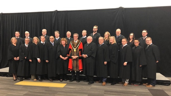 Ottawa's city councillors were sworn in Monday evening, seen here in the traditional inauguration photo along side Mayor Jim Watson.