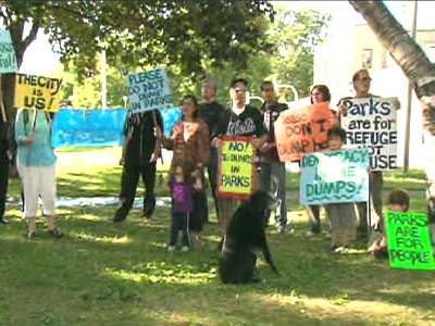 Protesters rally outside Moss Park, speaking out against dump sites set up in neighbourhood parks.