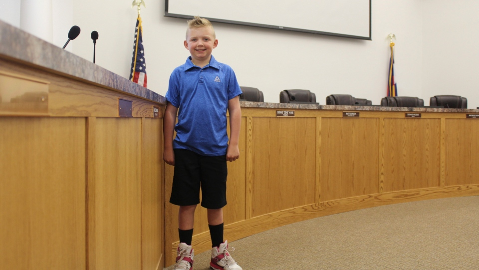 9-year-old Dane Best poses in the council chambers in Severance, Colo., Thursday, Nov. 29, 2018. (Sara Knuth/Greeley Tribune via AP)